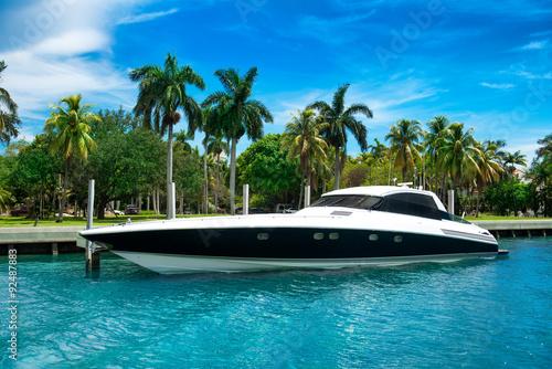 Luxury speed yacht near tropical island in Miami, Florida