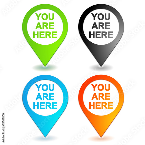 Photo  you are here on 4 colors geolocation symbol