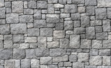 Fototapeta Kamienie - Old gray stone wall, seamless background texture