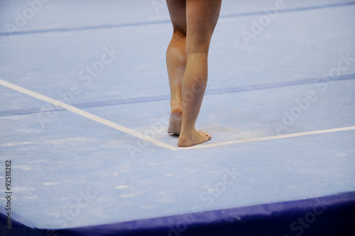 Feet on gymnastics floor Fototapeta