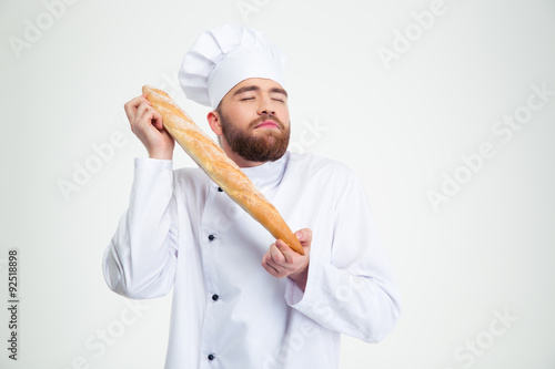Photo  Portrait of male chef cook holding fresh bread
