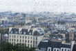 PARIS, FRANCE, on AUGUST 31, 2015. The top view from a survey platform on roofs of Paris through wet glass during a rain