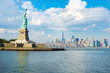 The Statue of Liberty with the downtown Manhattan skyline