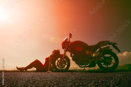 Fotografia, Obraz  Woman sitting on the wheel of the motorcycle