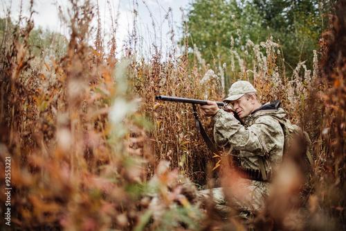 Foto op Aluminium Jacht man hunter with shotgun in forest