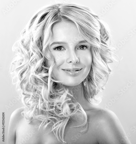 Foto op Canvas womenART Blonde woman with perfect curly hair. Young woman with gorgeou