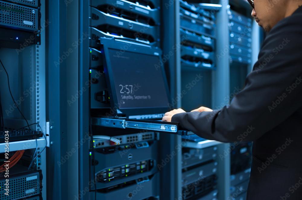 Fototapeta Man fix server network in data center room