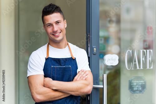 Fotografie, Obraz  Proud young cafe owner in doorway