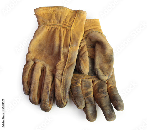 Fotografija  A pair of old used leather working gloves