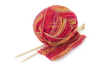 Ball Of Colorful Yarn, Wooden Knitting Needles, And A Piece Of Hand Knitted Textile. Pure White Background, Soft Shadows.