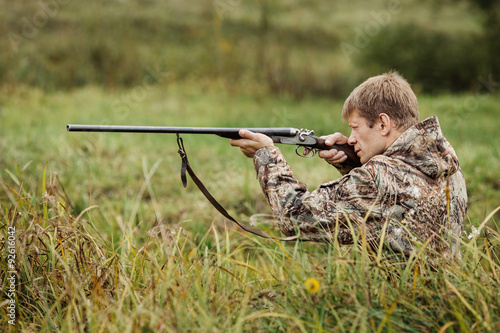 Fotobehang Jacht hunter in camouflage clothes ready to hunt with hunting rifle