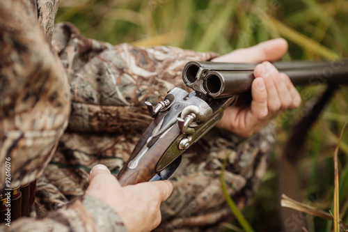 Foto op Aluminium Jacht hunter in camouflage clothes ready to hunt with hunting rifle