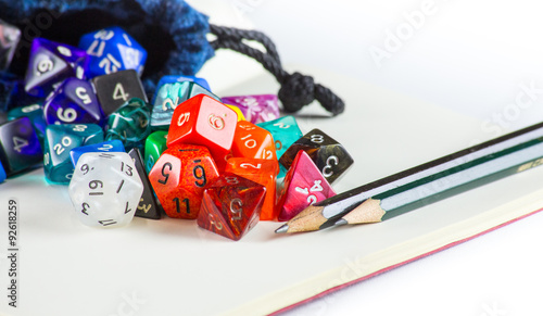 Leinwand Poster Dice spilling out of a Dice bag with Pencils