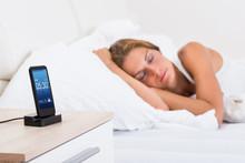 Woman Sleeping With Alarm On Mobile Phone