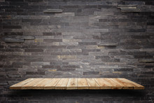 Empty Wooden Shelves And Stone Wall Background. For Product Disp
