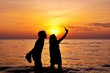 Silhouette of couple taking a photo together
