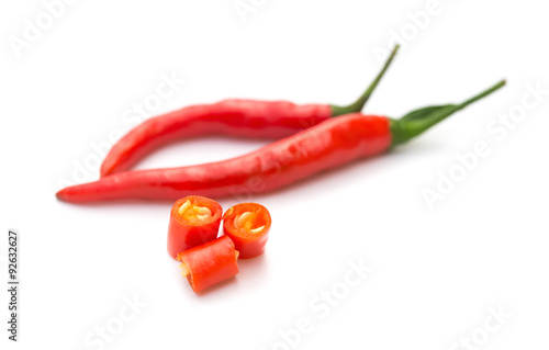 Fotobehang Hot chili peppers fresh and spicy cayenne with cut out sections on a white background