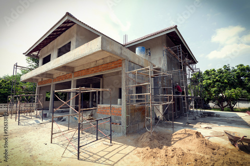 Obraz building residential construction house with scaffold steel - fototapety do salonu