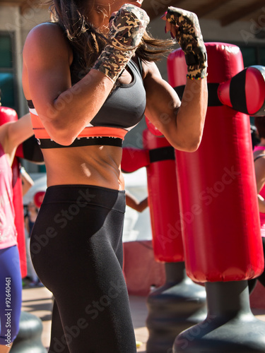 Photo Young Girl and Punching Bags, Boxing & Fitness
