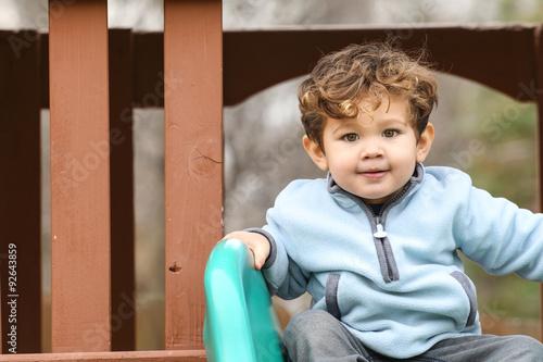Photo  Cute little boy at the park.