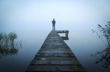 Man Standing On A Jetty At A L...
