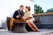 Cheerful couple on a terrace on autumn day