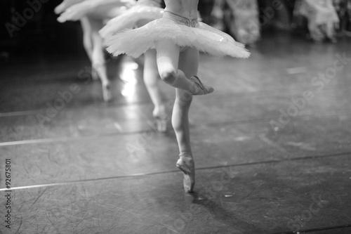 Slika na platnu Elegant and effortless-looking pirouettes,  low section of ballerinas