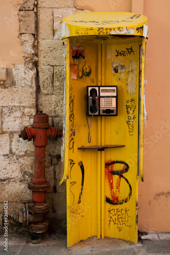 Hydrant and public telephone booth with a push button phone