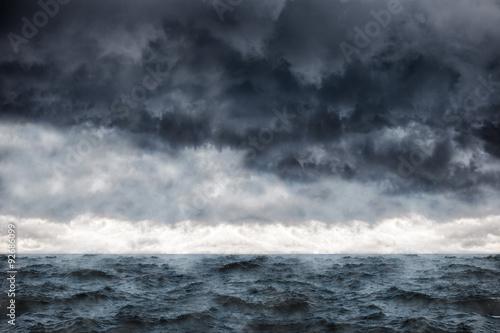 Staande foto Zee / Oceaan Dark clouds in the winter sky during a storm at sea.