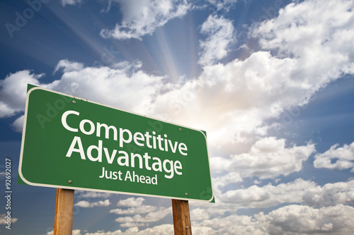 Photo  Competitive Advantage Green Road Sign Over Clouds