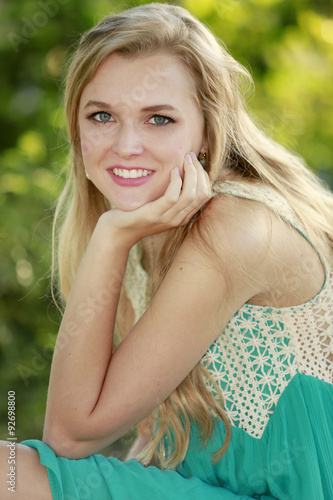 Photo  Outdoors portrait of beautiful young blonde girl