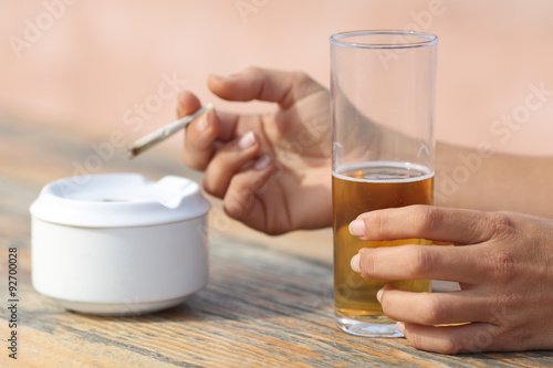 Tuinposter Bar Hands holding a cigarette smoking and drinking alcohol