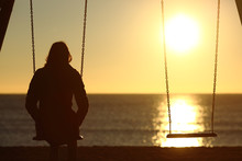 Lonely Woman Watching Sunset A...