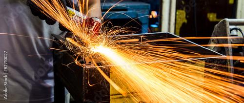 Photo  Angle grinder sparks close-up