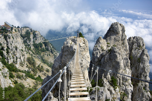 Fényképezés  Hanging bridge in mountains