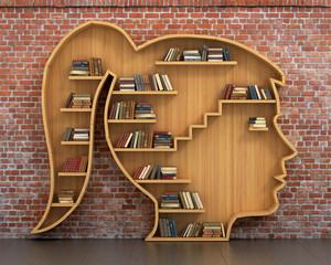 Concept of training. Wooden bookshelf full of books in form of w