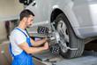 car mechanic installing sensor