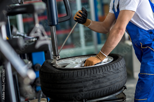 Fototapeta engineer  balancing  car wheel on balancer obraz