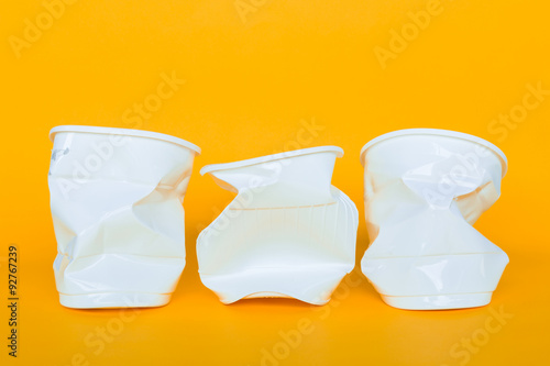 Plastic cups into the garbage