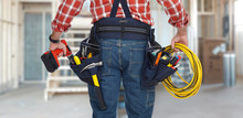 Electrician Man With Drill And Wire Cable.