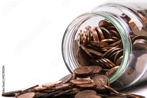 Cuadros en Lienzo British Penny Coins Spilling From A jar