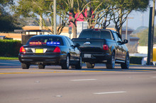 An Unmarked Police Car Has Pulled Over A Truck For A Traffic Violation
