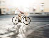 cyclist in blurred motion - 92803406