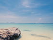 blue sky with sea and rock - soft focus with film filter