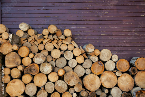 Fotografia  Background of wood logs and old wall, with copy space for text