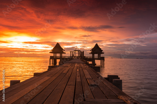 Spoed Foto op Canvas Bordeaux Twilight sunset wood bridge at Djittabhawan Temple