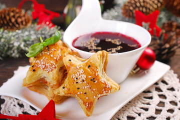 Fototapeta Boże Narodzenie/Nowy Rok puff pastries and red borscht for christmas eve