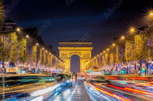 Fotografie, Obraz  Avenue des Champs-Elysees with Christmas lighting leading up to the Arc de Triom