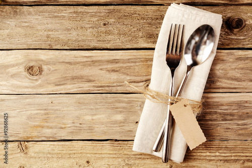Fotografie, Obraz  Spoon and Fork Tied on White Napkin with Tag