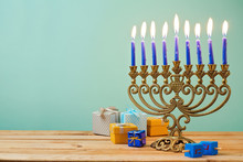 Jewish Holiday Hanukkah Background With Vintage Menorah And Gift Boxes On Wooden Table